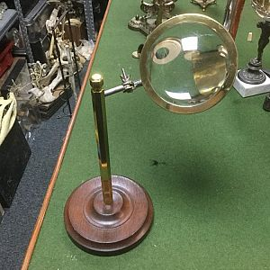 Magnifier on articulated brass stand