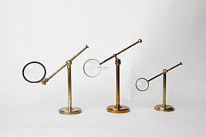 Magnifying glasses on brass stands