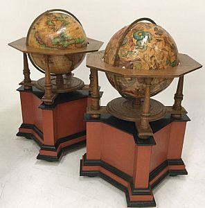 Pair of large globes on stands.