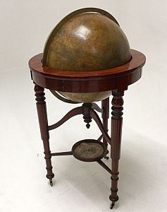 Antique globe on stand.