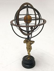 Armillary sphere on decorative stand.