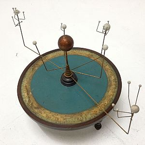 Orrery model on decorative base.