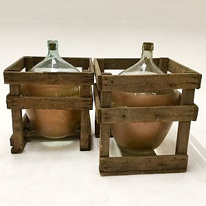 Large glass flagons in crates