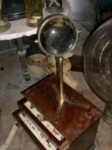 Large magnifier on brass stand