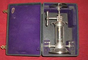 Cased syringe pump