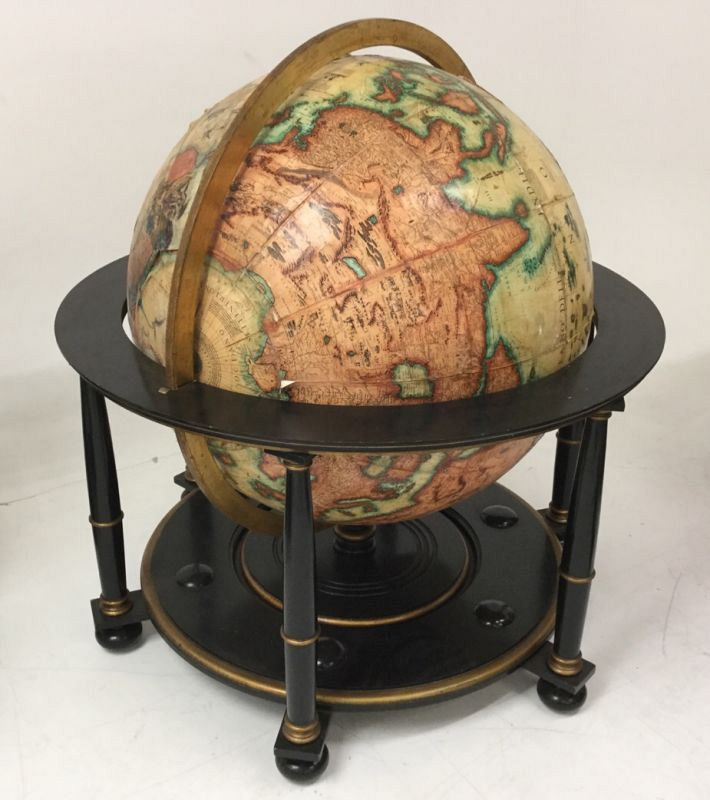 Very large globe on stand.