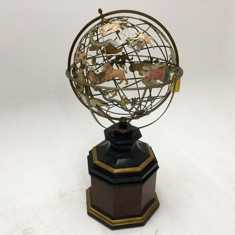Large astrology/zodiac globe on stand.