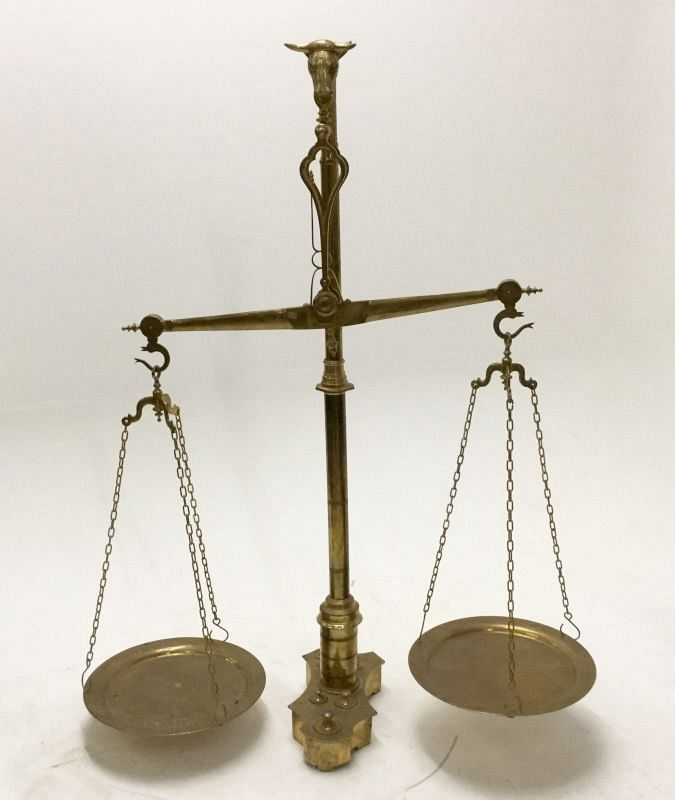 Very large brass weighing scales.