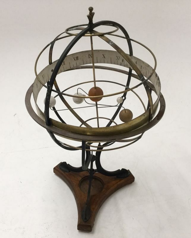 Armillary sphere on stand.
